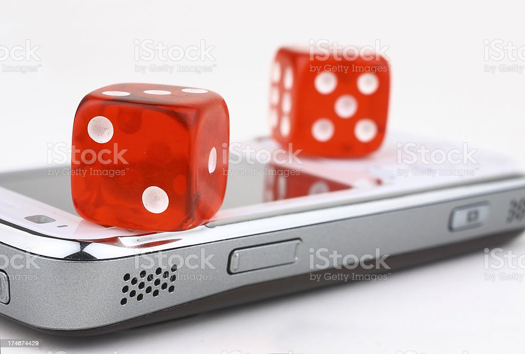 Mobile device and dice royalty-free stock photo