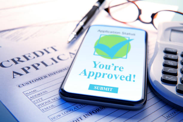Mobile Device On Credit Application Document stock photo