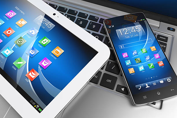 Mobile devices. Tablet PC, smartphone on laptop, technology concept stock photo