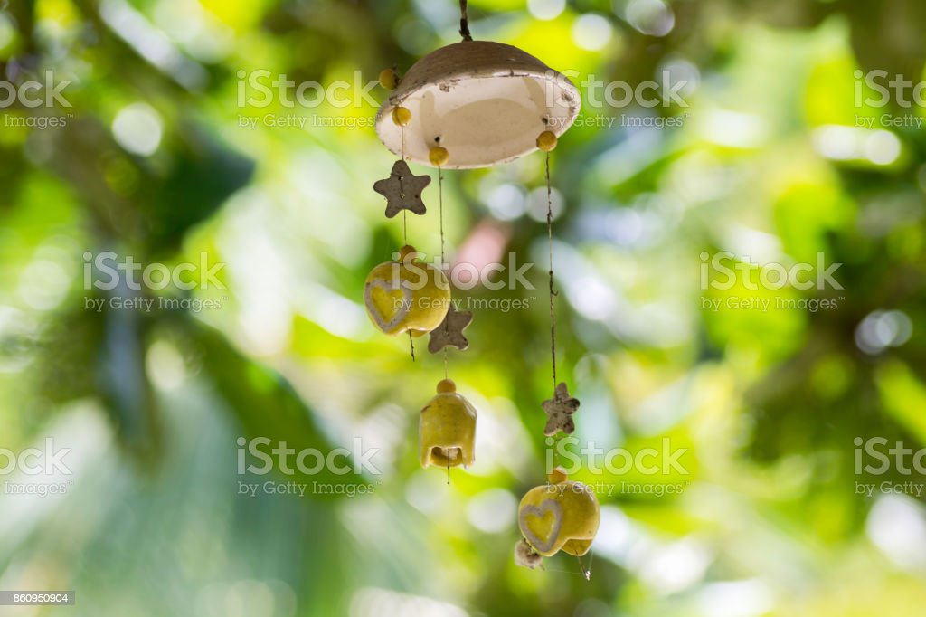 Mobile Hanging on Bokeh Background stock photo