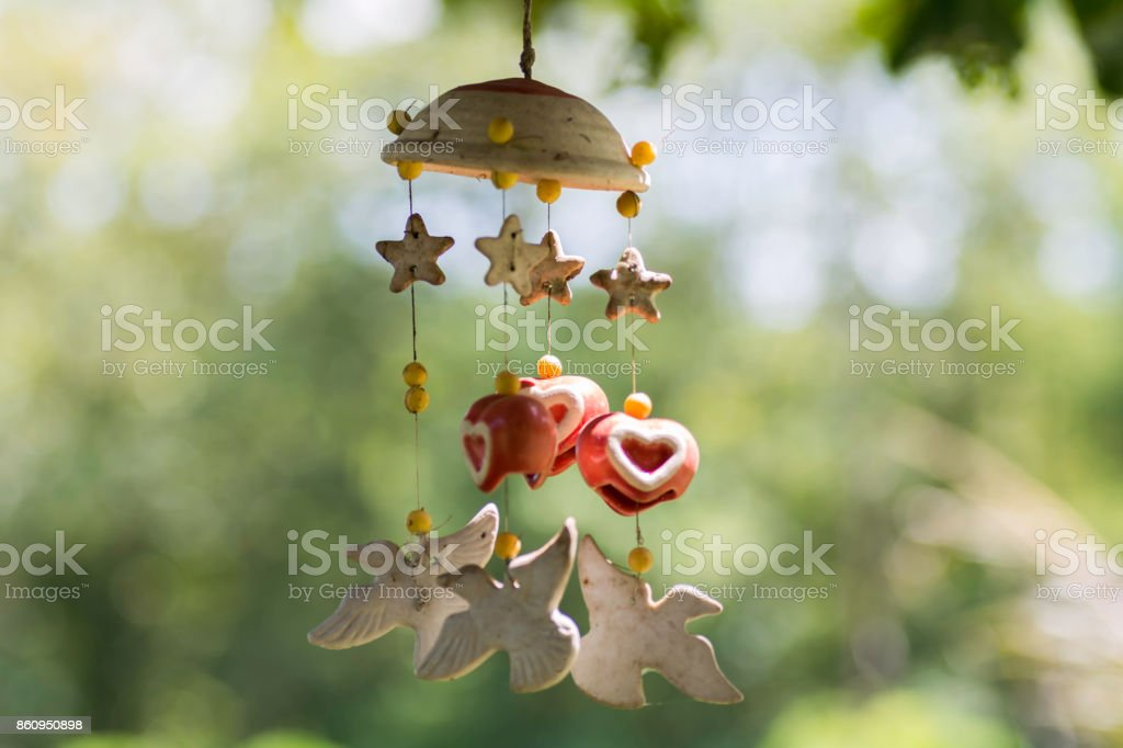 Mobile Hanging with sunset background stock photo