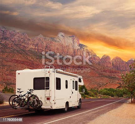 Highway road with motor home at sunset
