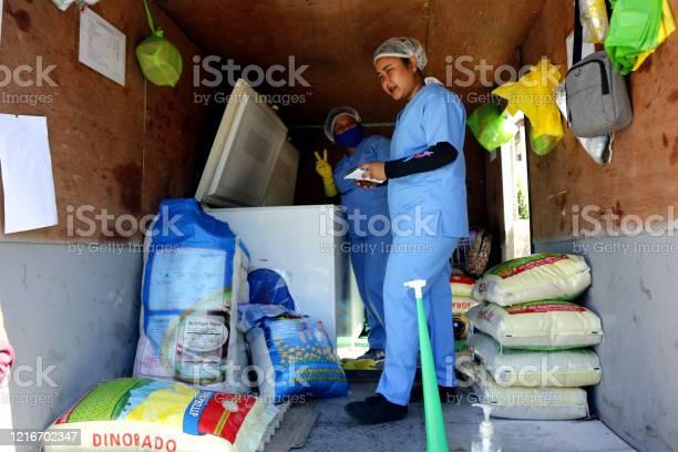 Mobile market workers go to communities during the lockdown due to picture id1216702347?b=1&k=6&m=1216702347&s=612x612&h=hcuyswuqxwho7aj1r3z5ir5zdcpmimb qxlhnyjv vm=