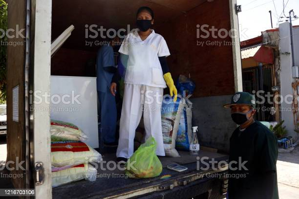 Mobile market workers go to communities during the lockdown due to picture id1216703106?b=1&k=6&m=1216703106&s=612x612&h=1rr8j2lak5z2y2sgsy9yticcvqsmg8qj9kz7j1kuqmo=