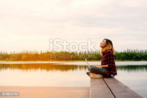 1043434558 istock photo Mobile office - beautiful happy woman enjoying fresh air on 615624752
