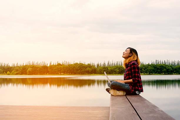 Mobile office beautiful happy woman enjoying fresh air on picture id615624752?b=1&k=6&m=615624752&s=612x612&w=0&h=hxy4h03rze5tbrcet 0vzxo6wgd4e0cpefpnkpa1js0=