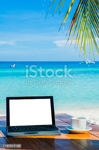 istock Mobile office under palm tree on tropical beach 1132312133