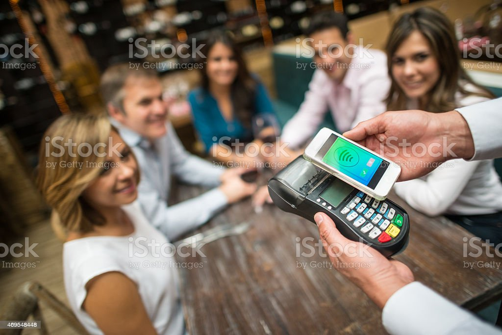 Mobile payment at a restaurant stock photo