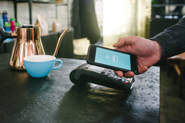 Mobile payment at cafe stock photo