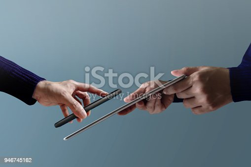 Mobile Payment Concept. Woman Customer using Smartphone to making Pay Transection with a Businessman