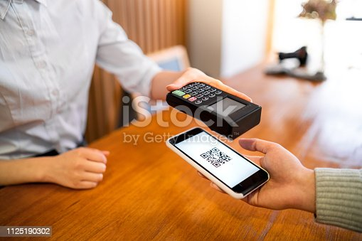 istock Mobile payment in a coffee shop 1125190302