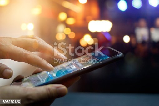 istock Mobile payment, Man using mobile payments online shopping and icon on night background, All on mobile screen are design up. 896570120