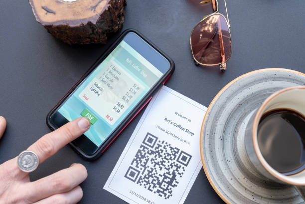 Mobile payment via QR code stock photo