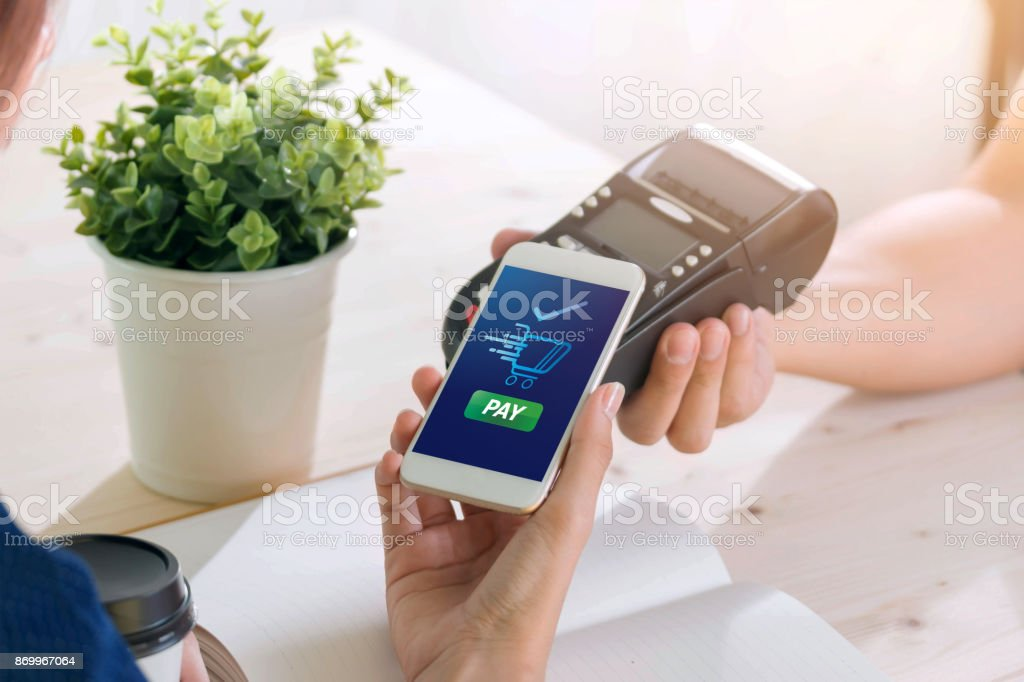 Mobile Payment with NFC technology  on Smartphone shopping online with filter effect stock photo