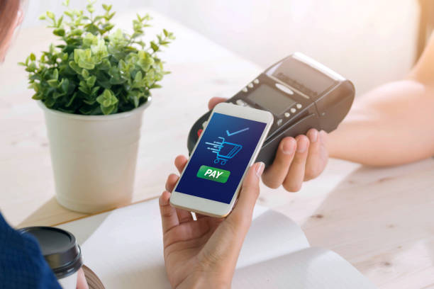 mobile payment with nfc technology  on smartphone shopping online with filter effect - contactless payment stock pictures, royalty-free photos & images