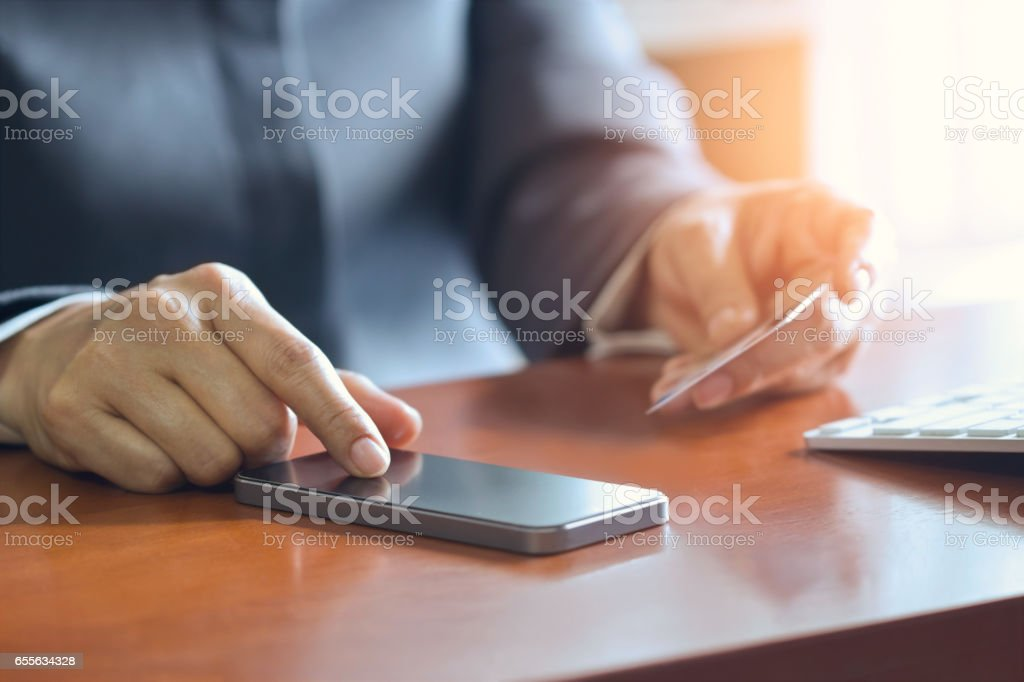 Mobile payments, female hands using smartphone and credit card for online shopping, m-banking stock photo