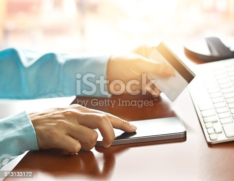 508915178istockphoto Mobile payments, using smartphone and credit card for online shopping 513133172