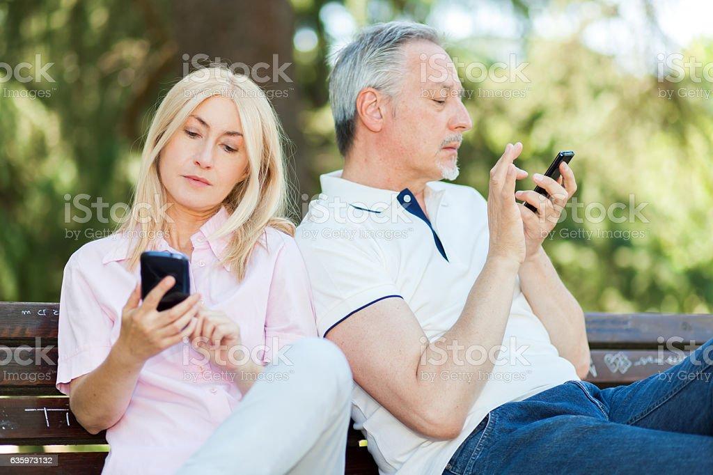Mobile phone addiction concept stock photo