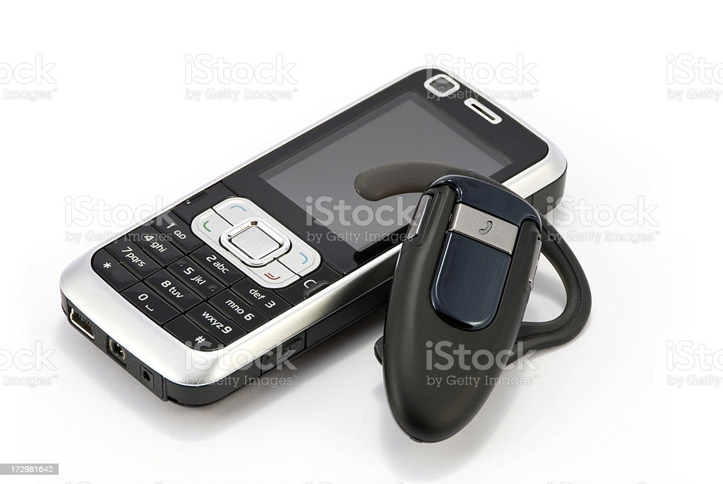 mobile phone and bluetooth headphone royalty-free stock photo