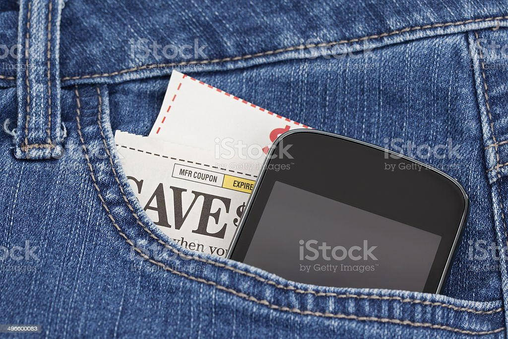 Mobile Phone and Coupons in Pocket stock photo