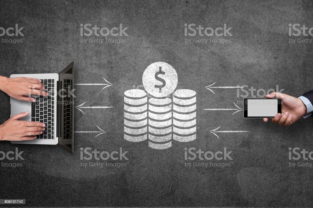 Mobile phone and laptop with financial concept on blackboard stock photo