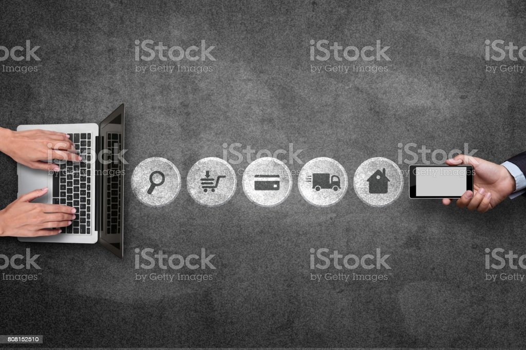 Mobile phone and laptop with online shopping process icons stock photo