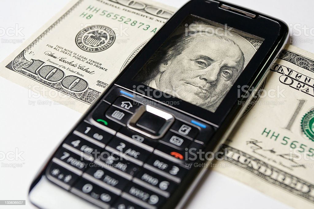 Mobile Phone and money royalty-free stock photo