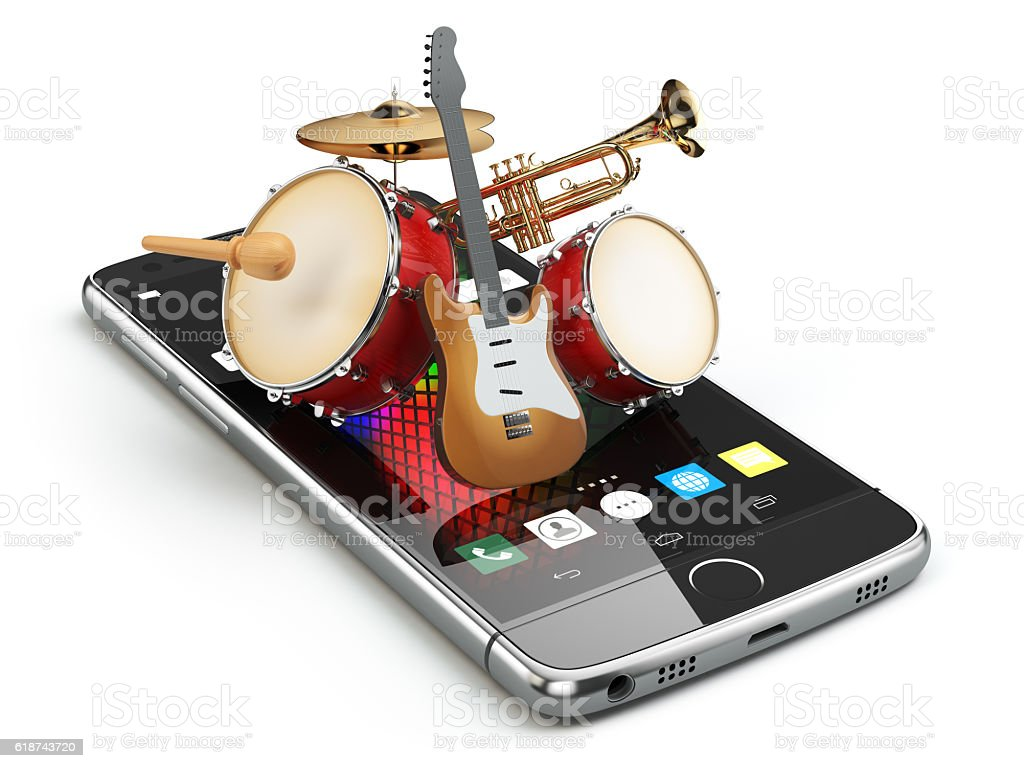 Mobile phone and musical instruments. Guitar, drums and trumpet. stock photo