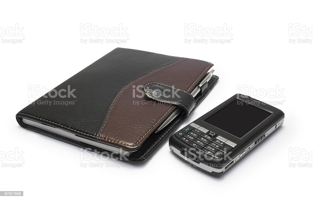 Mobile phone and notebook royalty-free stock photo