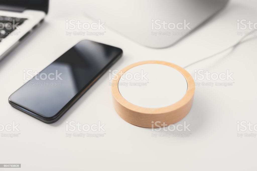 Mobile phone and wireless charger stock photo