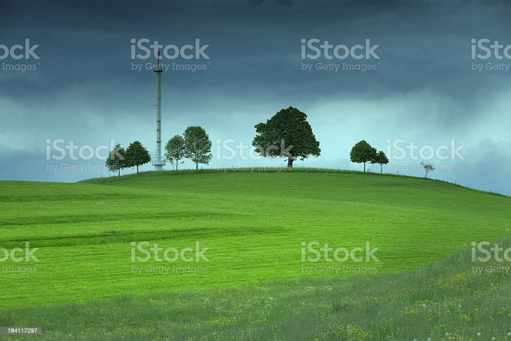 Mobile phone antennae on a green field stock photo
