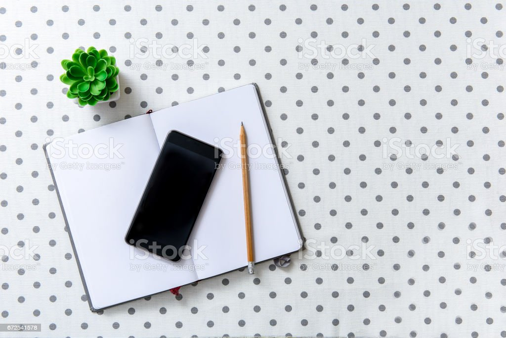 Mobile phone at white sheet of paper stock photo