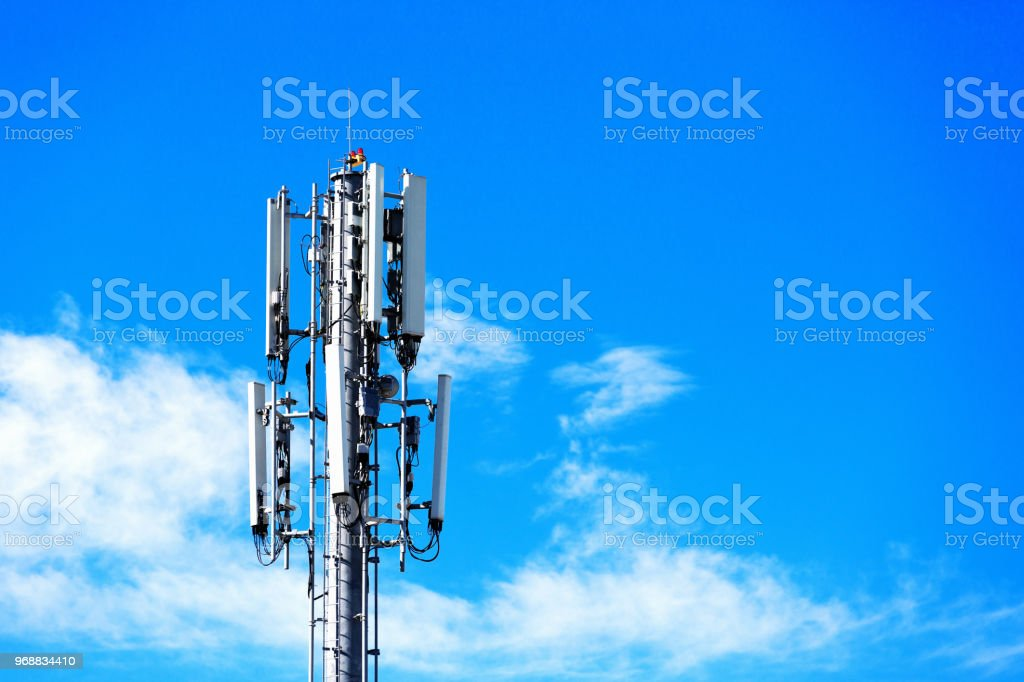 Mobile Phone Base Station Antenna Against A Partly Cloudy