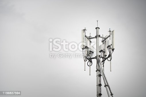 3G, 4G, 5G. Mobile phone base station Tower. Development of communication system in urban area with blue sky background.