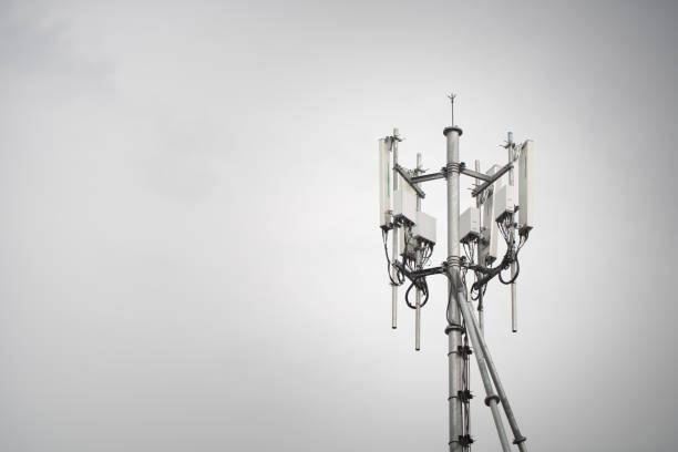 Mobile phone base station Tower. 3G, 4G, 5G. Mobile phone base station Tower. Development of communication system in urban area with blue sky background. antenna aerial stock pictures, royalty-free photos & images