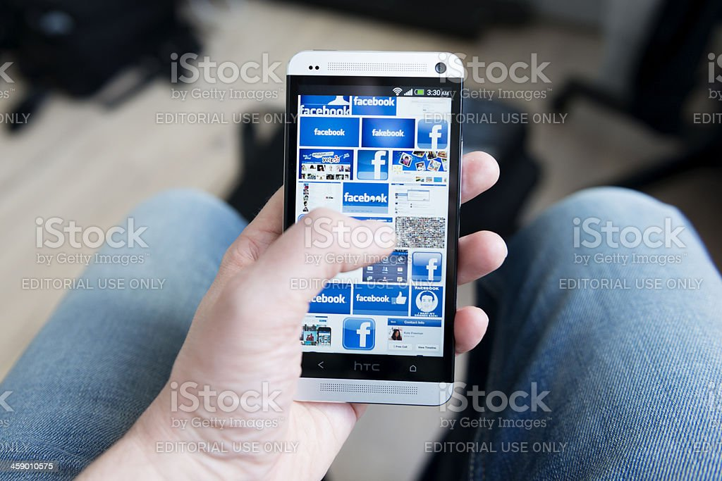 Mobile phone full of logos for Facebook stock photo