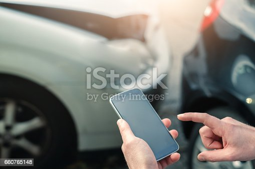 istock Mobile phone help calling after a car accident 660765148