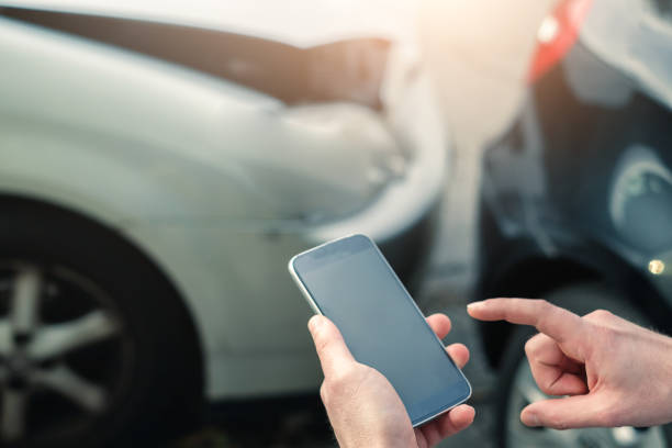 mobile phone help calling after a car accident - impaired driving stock photos and pictures