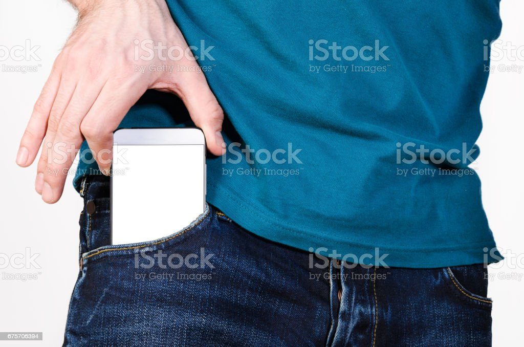 Mobile phone in a pocket 免版稅 stock photo