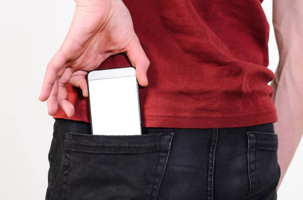 Telefone móvel em um bolso - foto de acervo