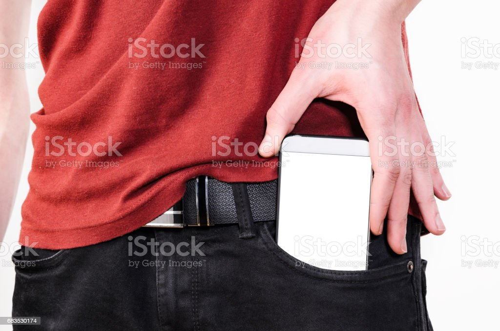 Mobile phone in a pocket stock photo
