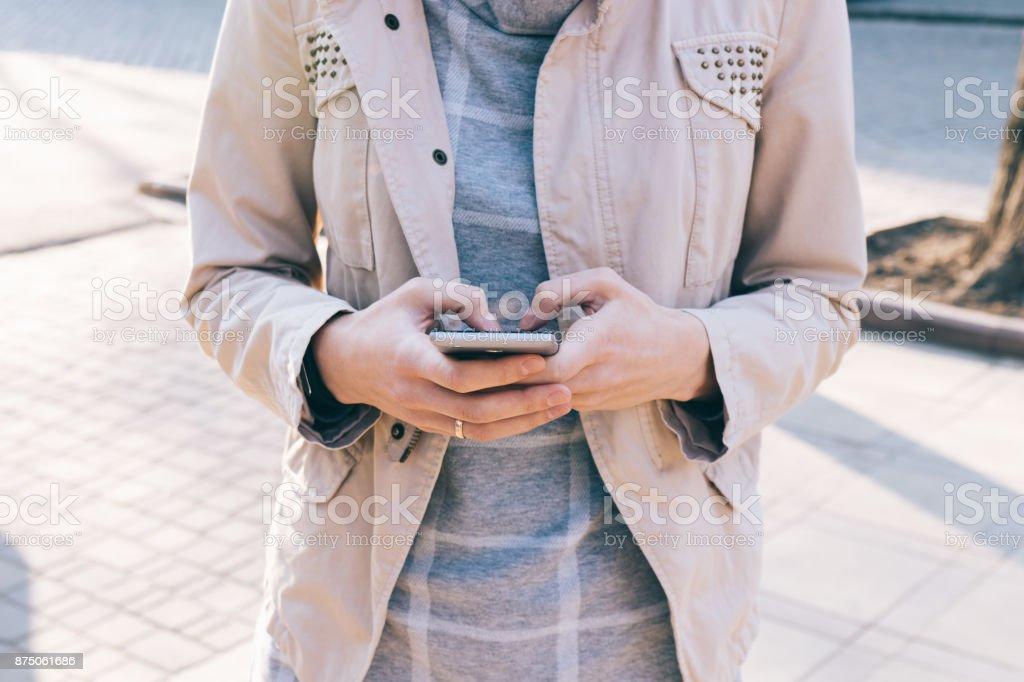Mobile phone in female hands stock photo