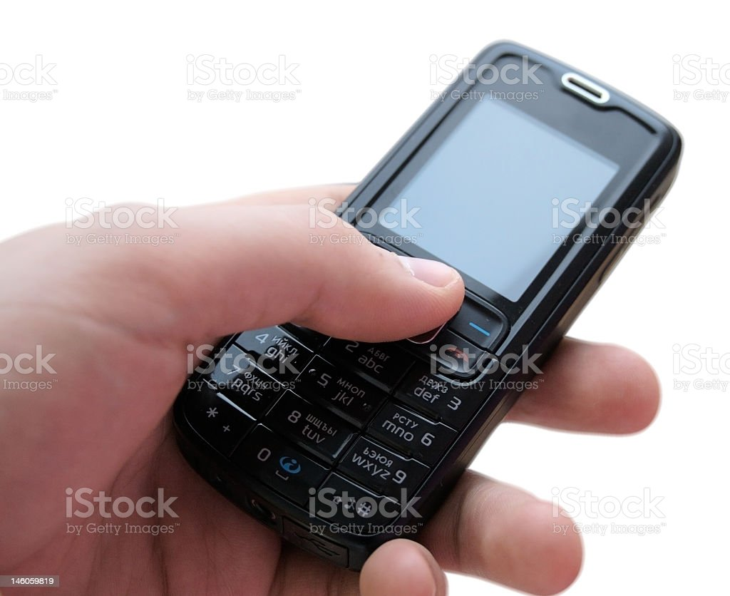 Mobile phone in hand on white background royalty-free stock photo