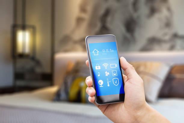 mobile phone in modern bedroom stock photo