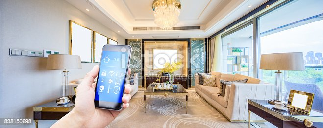 istock mobile phone in modern living room 838150698