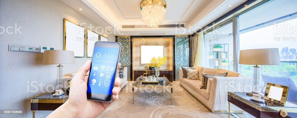 mobile phone in modern living room stock photo