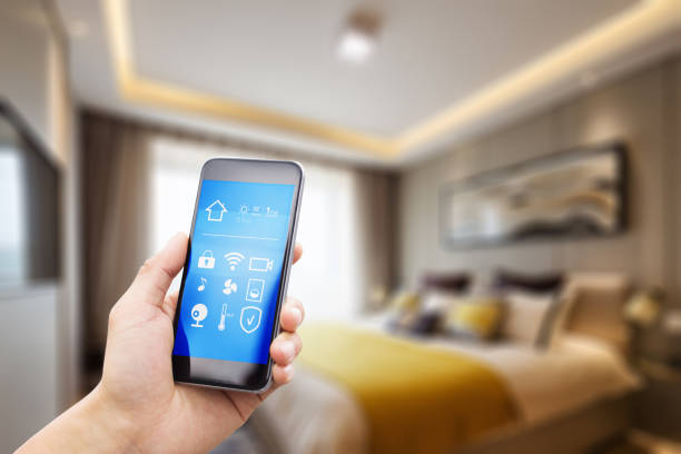 mobile phone in smart home stock photo