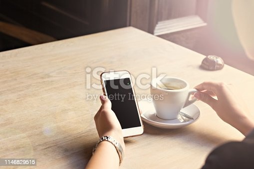 istock mobile phone in woman's hands 1146829515