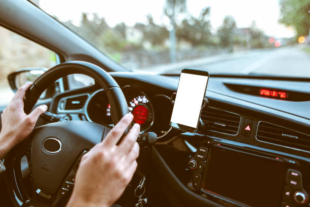 mobile phone inside car - dashboard vehicle part stock photos and pictures