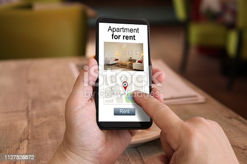 1023041738istockphoto Mobile phone internet search apartment house holiday home rental 1127526872